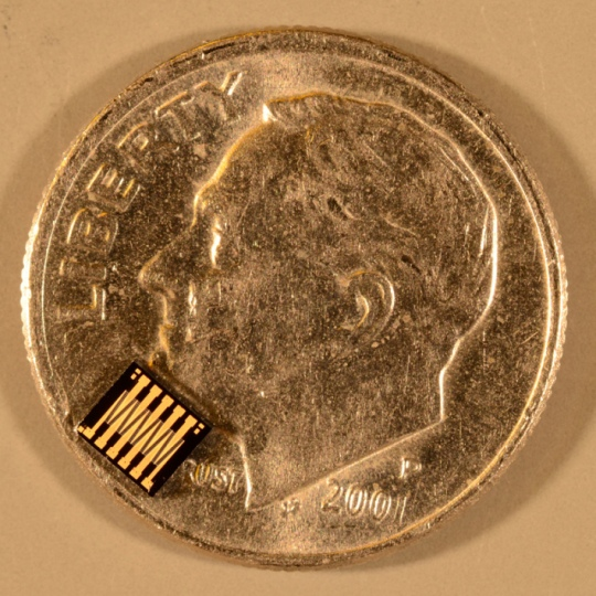 A die containing 400 MEMS switches on a U.S. dime (source: GE)